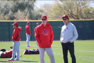Joe Maddon (left) and Tony La Russa (right) standing around with their hands in their pockets.