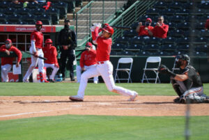 Shohei Ohtani batting at a spring training game against the Giants